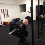Jeff doing a back squat at CrossFit Blackwater's gym in Witham, Essex